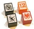 Hunger Games Set of Four Pre-Inked Stamps Mockingjay District 12 Tribute and Capitol